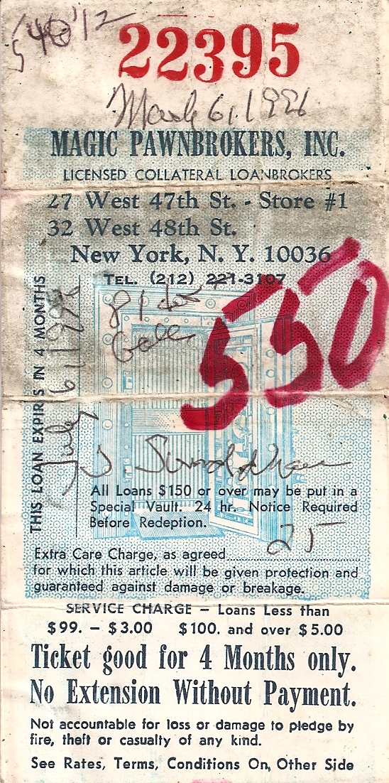 photo of warn and folded pawn ticket